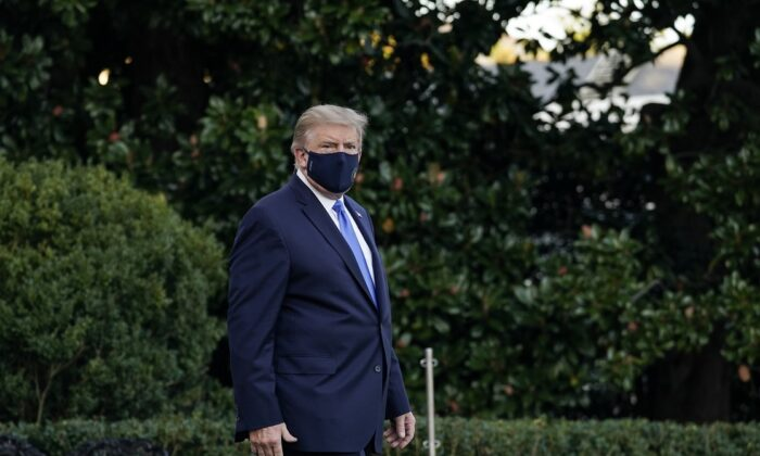 President Donald Trump leaves the White House for Walter Reed National Military Medical Center on the South Lawn of the White House in Washington on Oct. 2, 2020. (Drew Angerer/Getty Images)