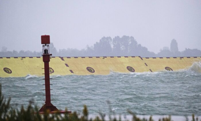 Mose flood barrier scheme is used for the first time, in Venice, Italy, on Oct. 3, 2020. (Manuel Silvestri/Reuters)