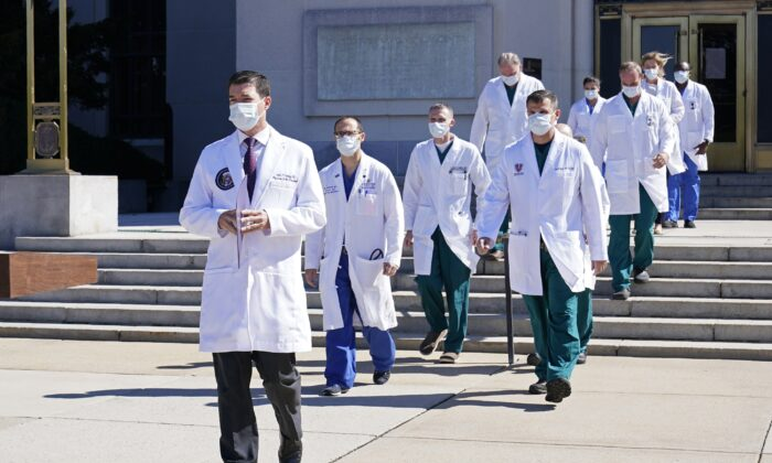 Dr. Sean Conley, physician to President Donald Trump, is followed by a team of doctors for a briefing with reporters at Walter Reed National Military Medical Center in Bethesda, Md., on Oct. 3, 2020. (Susan Walsh/AP Photo)