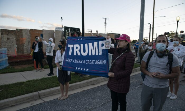 Supporters of President Donald Trump stand outside Walter Reed National Military Medical Center in Bethesda, Md., on Oct. 2, 2020. (Alex Edelman/Getty Images)