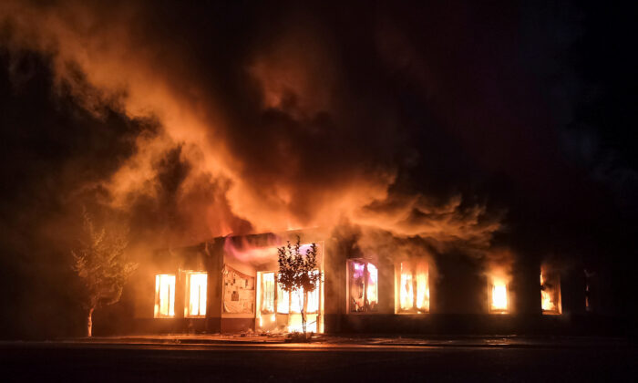 A shop is seen on fire following recent shelling during a military conflict over the breakaway region of Nagorno-Karabakh in Stepanakert, on Oct. 3, 2020. (Gor Kroyan/Reuters)
