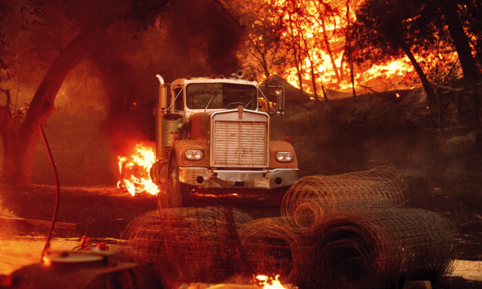 Flames from the Glass Fire burn a truck in a Calistoga, Calif., vineyard on Oct. 1, 2020. (Noah Berger/AP Photo)