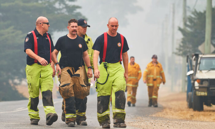 Fire Rescue Queensland crews are pictured in Wingello, Australia on Jan. 5, 2020. (Brett Hemmings/Getty Images)