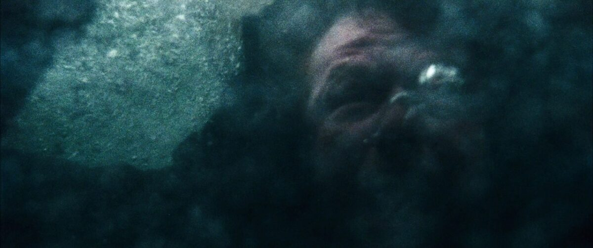 """man's face underwater in """"The Grey"""""""