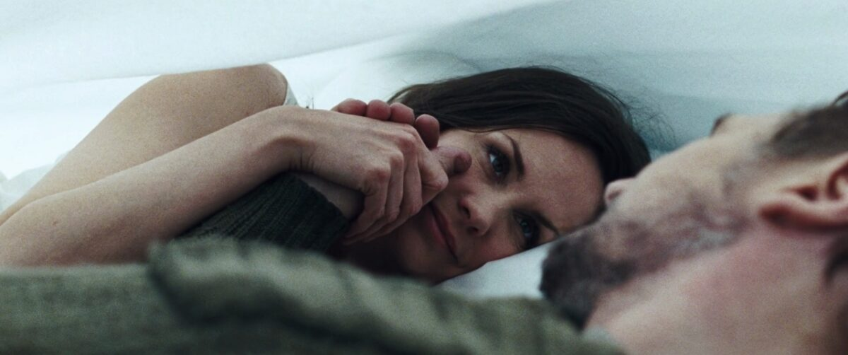 """man and women under a sheet in """"The Grey"""""""