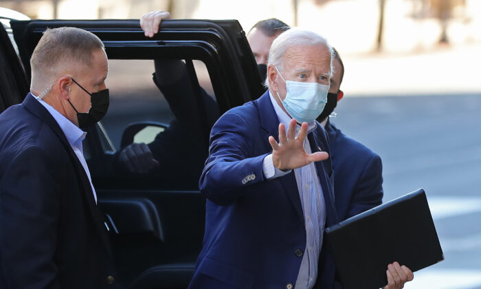 Democratic presidential nominee Joe Biden waves to journalists as he enters the Queen Theater in Wilmington, Del., Oct. 3, 2020. (Chip Somodevilla/Getty Images)