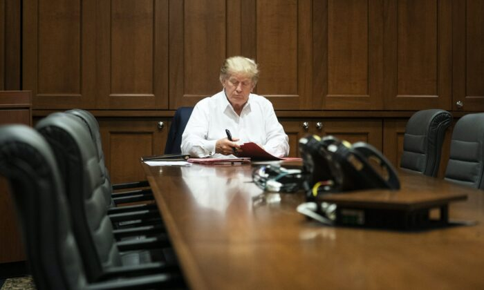President Donald Trump working in the presidential suite at the Walter Reed National Military Medical Center on Oct. 3, 2020. (Joyce N. Boghosian/White House)