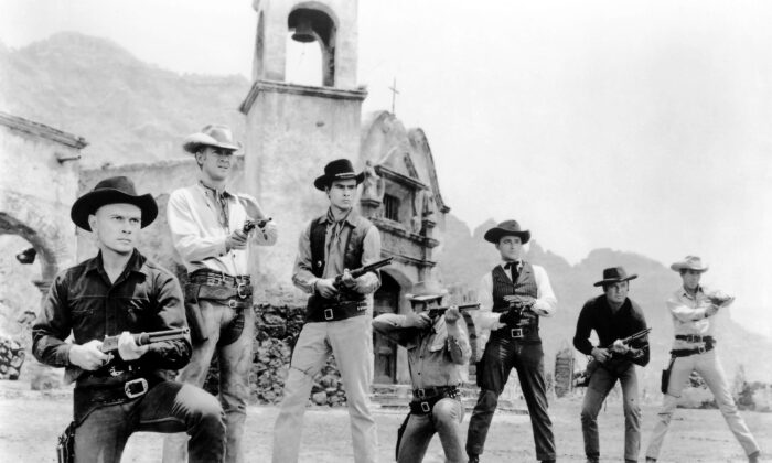 "Yul Brynner, Steve McQueen, Horst Buchholz, Charles Bronson, Robert Vaughn, Brad Dexter, and James Coburn in a publicity shot for ""The Magnificent Seven."" Fox Film Corporation. (Public Domain)"