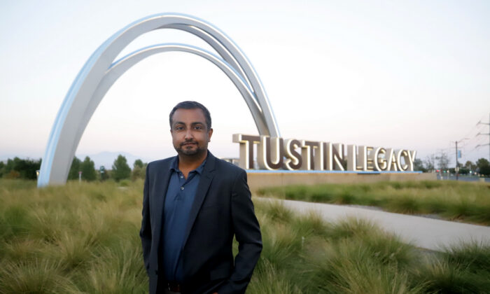 Tustin City Council candidate AJ Jha stands on a parcel of land open for development in Tustin, Calif. (Courtesy of AJ Jha)