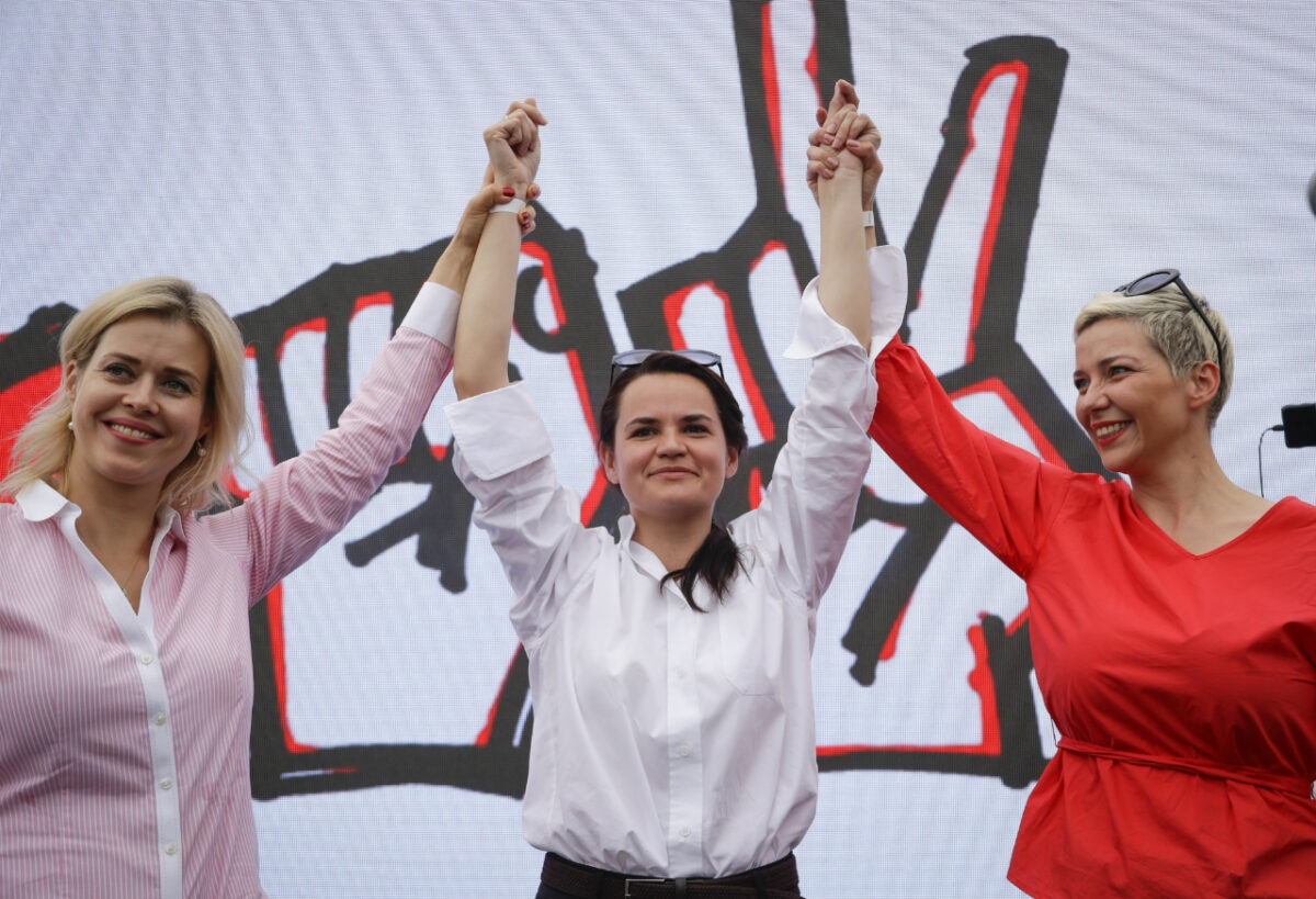 In this July 19, 2020, file photo, Maria Kolesnikova, a representative of Viktor Babariko, right, Sviatlana Tsikhanouskaya, candidate for the presidential elections, center, and wife of non-registered candidate Valery Tsepkalo, Veronika Tsepkalo, left, gesture during a meeting in support of Sviatlana Tsikhanouskaya in Minsk, Belarus. (Sergei Grits/AP Photo, File)