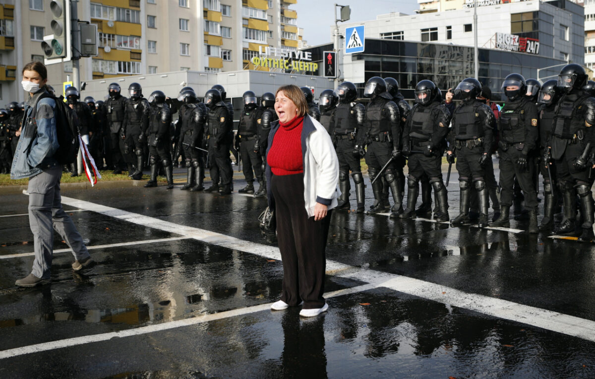 A protester shouts in front of a riot police line during a rally in Minsk, Belarus, Sunday, Oct. 4, 2020. (AP Photo)