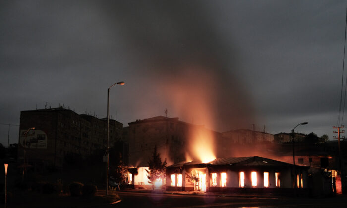 A residential building burns after night of shelling during a military conflict in self-proclaimed Republic of Nagorno-Karabakh, Stepanakert, Azerbaijan, on Oct. 4, 2020. (Areg Balayan/ArmGov PAN Photo via AP)