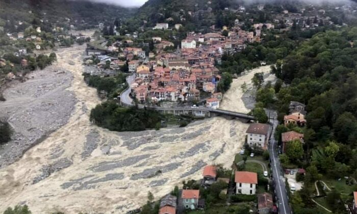 This aerial view provided on Oct.4, 2020 by the Alpes Maritimes region fire brigade show a house keeping a fragile balance on a hill while a rive floods on Oct.3. 2020 near La Vesubie, southern France. (SDIS 06 via AP)