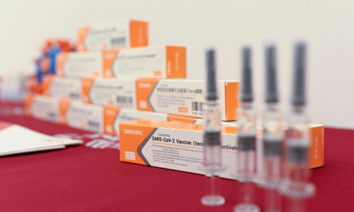 Sinovac Biotech vaccines, one of 11 Chinese companies approved to carry out clinical trials of potential coronavirus vaccines, are displayed at a press conference in Beijing, China on Sept. 24, 2020. (WANG ZHAO/AFP via Getty Images)