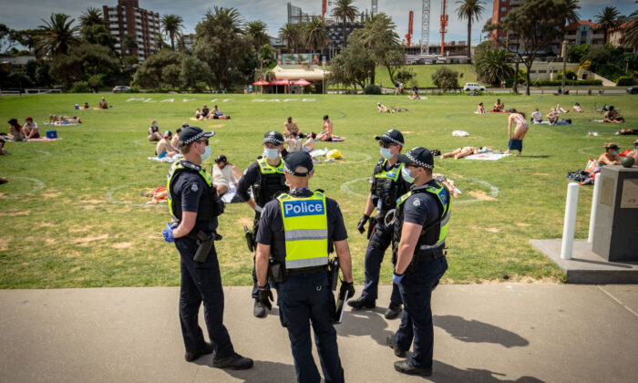 Victoria Police patrol at St Kilda beach in Melbourne, Australia on Oct. 3, 2020. (Darrian Traynor/Getty Images)