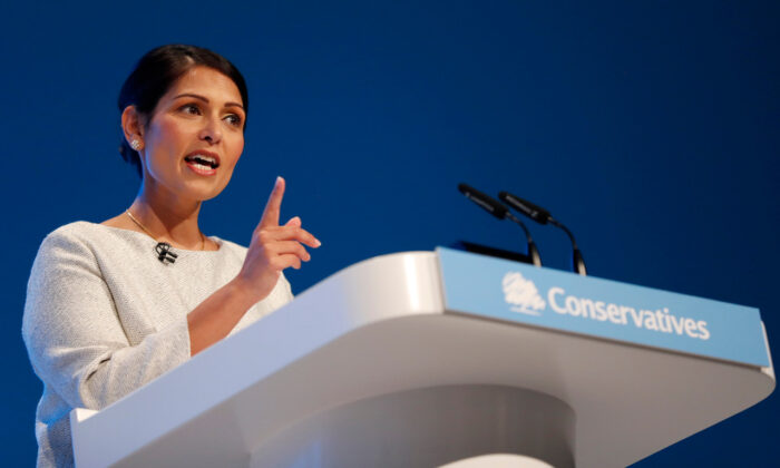 Britain's Home Secretary, Priti Patel, addresses the delegates at last year's Conservative Party Conference in Manchester, England, on Oct. 1, 2019. (AP Photo/Frank Augstein)