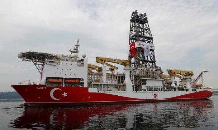 Turkish drilling vessel Yavuz sets sail in Izmit Bay, on its way to the Mediterranean Sea, off the port of Dilovasi, Turkey, on June 20, 2019. (Sezer/Reuters)