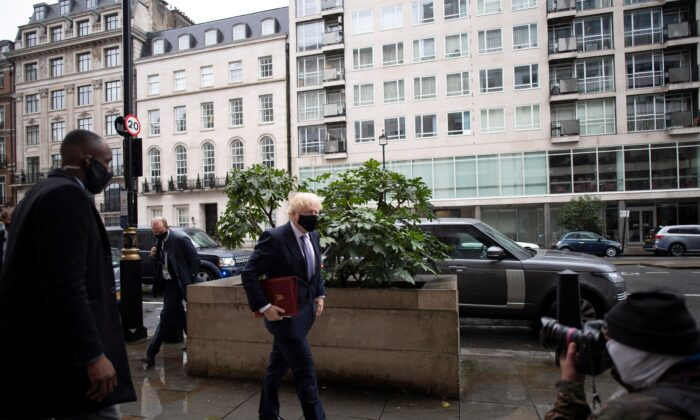Britain's Prime Minister Boris Johnson wears a protective face covering as he arrives at the BBC in central London on October 4, 2020.(Justin Tallis/AFP via Getty Images)