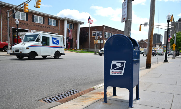 Cars drive past a mailbox in Morristown, N.J, on Aug. 17, 2020. (Theo Wargo/Getty Images)
