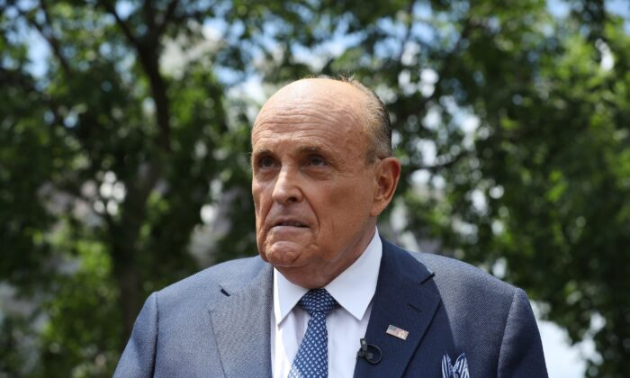 President Donald Trump's lawyer and former New York City Mayor Rudy Giuliani speaks to reporters outside the White House on July 1, 2020. (Chip Somodevilla/Getty Images)