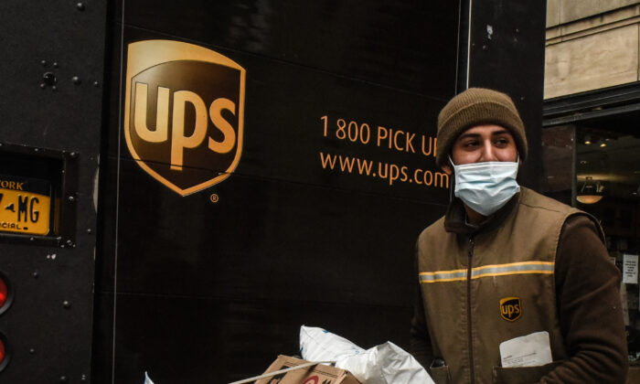 A UPS worker delivers packages in New York on April 29, 2020. (Stephanie Keith/Getty Images)