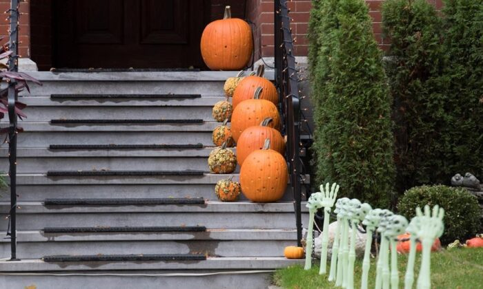Halloween decorations and pumpkins are shown at a house in Montreal,  on Nov. 1, 2019. (The Canadian Press/Graham Hughes)