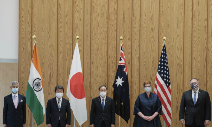 From left to right, Indian Minister of External Affairs Subrahmanyam Jaishankar, Japanese Foreign Minister Toshimitsu Motegi, Japanese Prime Minister Yoshihide Suga, Australian Foreign Minister Marise Payne and U.S. Secretary of State Mike Pompeo pose for a picture before a four Indo-Pacific nations' foreign ministers meeting at the prime minister's office in Tokyo, on Oct. 6, 2020. (Nicolas Datiche/Pool Photo via AP)