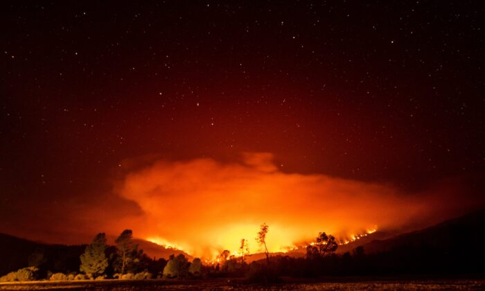 The August Complex Fire burns near Lake Pillsbury in the Mendocino National Forest, Calif., on Sept. 16, 2020. (Noah Berger/AP Photo)
