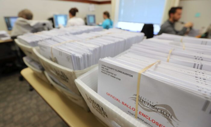 Thousands of ballots sit in boxes as Utah County election workers process the mail-in ballots for the midterm elections in Provo, Utah, on Nov. 6, 2018. (George Frey/Getty Images)
