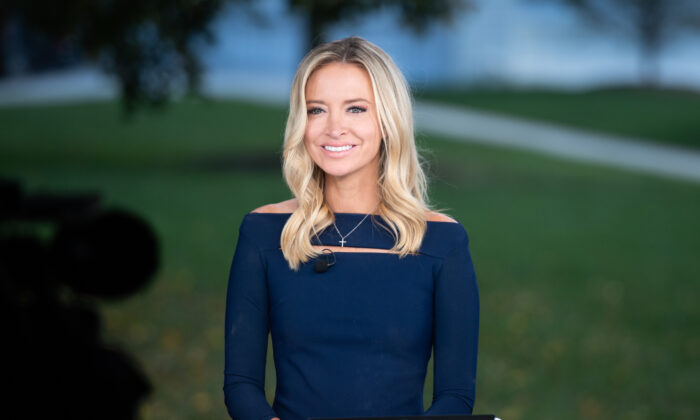 White House press secretary Kayleigh McEnany speaks during a television interview at the White House in Washington, DC, Oct. 2, 2020. (Saul Loeb/AFP via Getty Images)