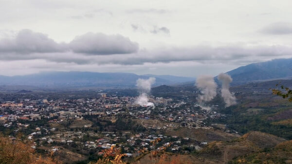 Smoke rises above the city