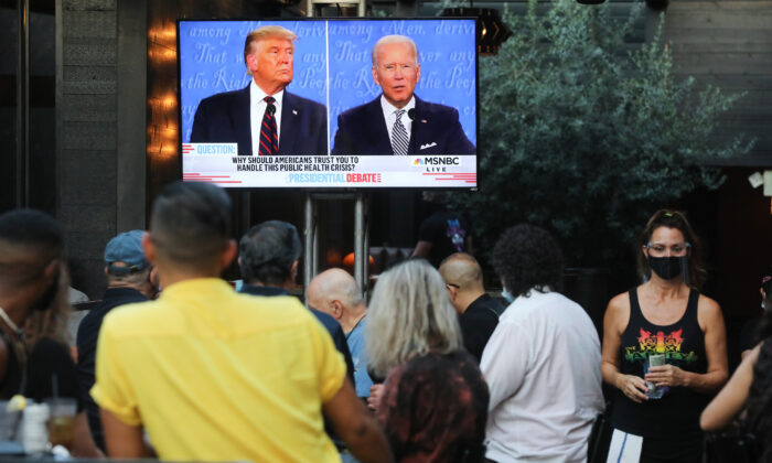 People sit and watch a broadcast of the first debate between President Donald Trump and Democratic presidential nominee Joe Biden at The Abbey in West Hollywood, California, on September 29, 2020. (Mario Tama/Getty Images)