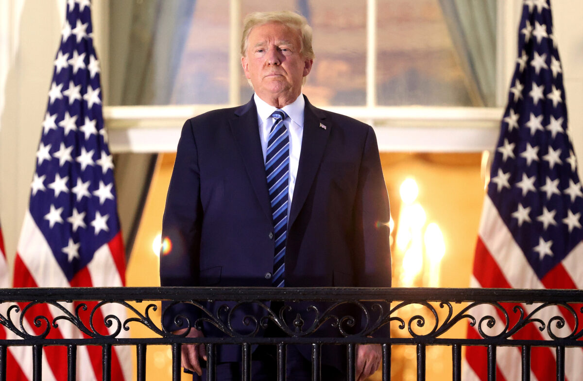 Trump stands on the Truman Balcony