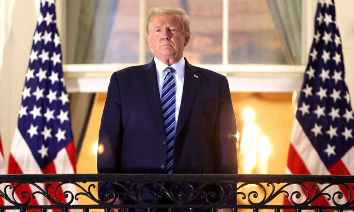 President Donald Trump stands on the Truman Balcony after returning from Walter Reed National Military Medical Center, at the White House in Washington on Oct. 5, 2020. (Win McNamee/Getty Images)