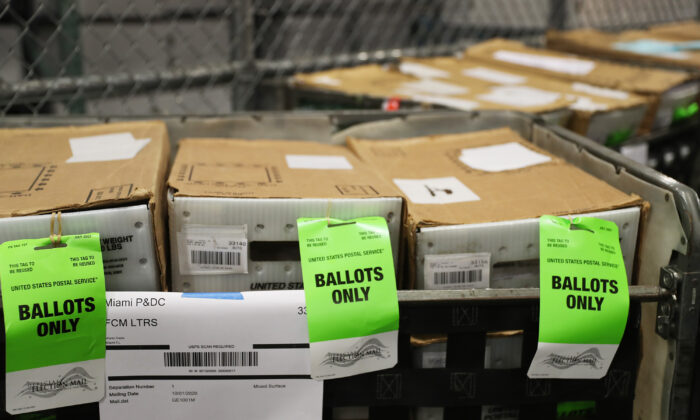 Boxes with ballots are seen at the Miami-Dade County Election Department as the vote-by-mail ballots are placed on to a U.S. Post Office truck to be delivered to voters, in Doral, Fla., Oct. 1, 2020. (Joe Raedle/Getty Images)