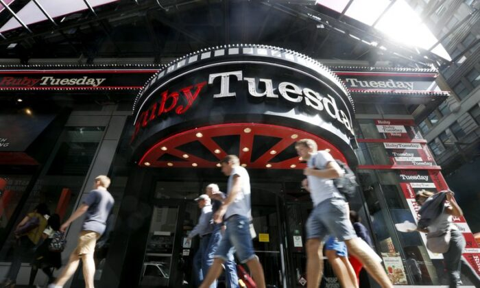 In this Sept. 16, 2016 file photo, visitors to New York's Times square walk past a Ruby Tuesday restaurant. (Mary Altaffer/AP Photo File)