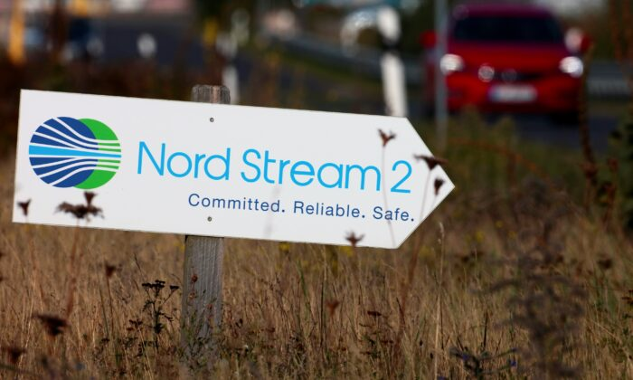 A road sign directs traffic towards the Nord Stream 2 gas line landfall facility entrance in Lubmin, Germany, on Sept. 10, 2020. (Hannibal Hanschke/Reuters)