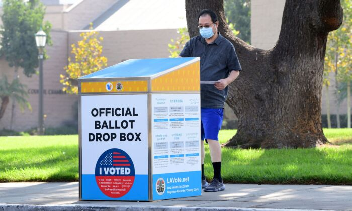 A ballot is dropped off at an official ballot drop box in Monterey Park, Calif., on Oct. 5, 2020. (Frederic J. Brown/AFP via Getty Images)