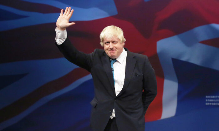 Then-London mayor Boris Johnson waves after speaking to the conference on the third day of the Conservative Party conference in Manchester, England, on Oct. 6, 2015. (Dan Kitwood/Getty Images)