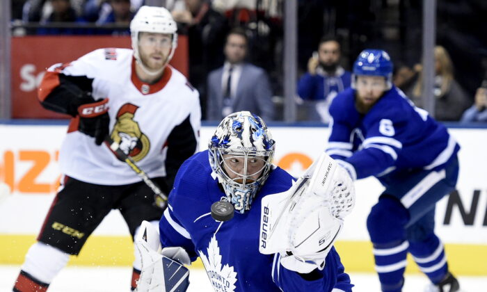 Toronto Maple Leafs goaltender Frederik Andersen (31) makes a glove save during first period NHL hockey action against the Ottawa Senators, in Toronto on Wednesday, October 2, 2019. (The Canadian Press/Nathan Denette)