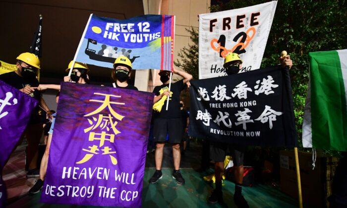 """Protesters supporting Hong Kong gather across the road from the Chinese Consulate in Los Angeles on October 1, 2020 during a global day of action called by """"Resist China"""" (#ResistChina), a global campaign against the regime of the Chinese Communist Party. (Photo by FREDERIC J. BROWN/AFP via Getty Images)"""