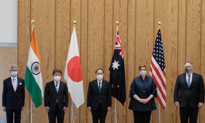 (L-R) India's Foreign Minister Subrahmanyam Jaishankar, Japan's Foreign Minister Toshimitsu Motegi, Japan's PM Yoshihide Suga, Australia's Foreign Minister Marise Payne and U.S. Secretary of State Mike Pompeo pose for photographs before a Quad Indo-Pacific meeting at the prime minister's office in Tokyo on Oct. 6, 2020. (Nicolas Datiche/Pool/AFP via Getty Images)