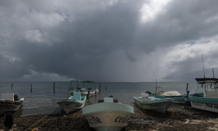 Boats sit closer to the shore after they were secured by fishermen preparing for the arrival of Hurricane Delta in Puerto Juarez, Cancun, Mexico, on Oct. 6, 2020.  (Victor Ruiz Garcia/AP Photo)