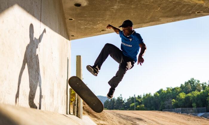 Skateboarder Kwami Adzitso lands a trick in Laguna Niguel, Calif., on Sept. 30, 2020. (John Fredricks/The Epoch Times)