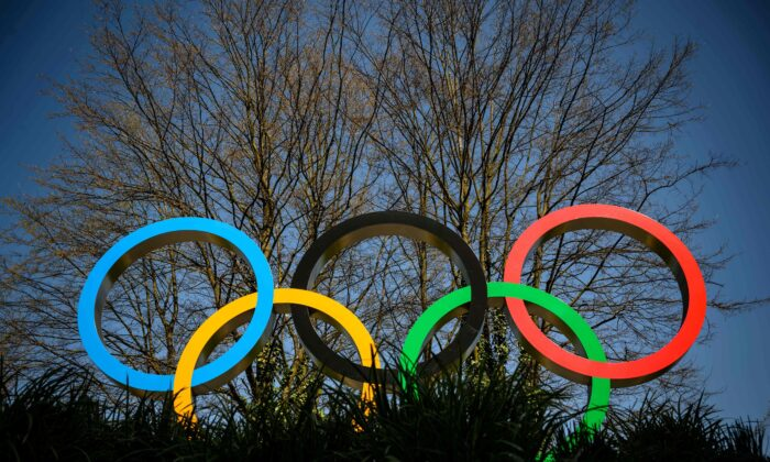 The Olympic Rings logo is pictured in front of the headquarters of the International Olympic Committee (IOC) in Lausanne on March 18, 2020. (Fabrice Coffrini /AFP via Getty Images)