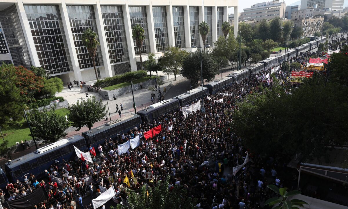 Thousands of people gather for a protest outside a court in Athens