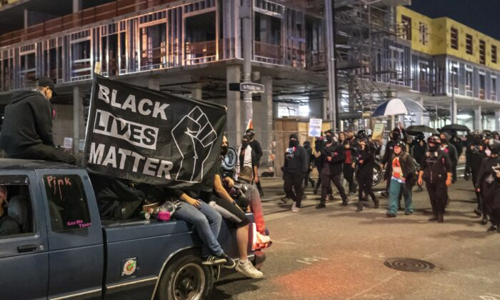 Anti-police protesters march in Portland, Ore., before the event turned into a riot, Oct. 6, 2020. (Nathan Howard/Getty Images)