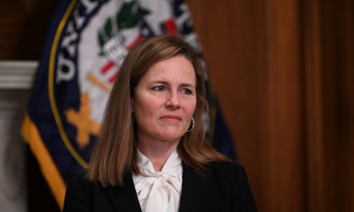 Judge Amy Coney Barrett, President Donald Trump's nominee to the Supreme Court, attends a meeting with Sen. Joni Ernst (R-Iowa) on Capitol Hill in Washington on Oct. 1, 2020. (Erin Scott/Pool/Reuters)