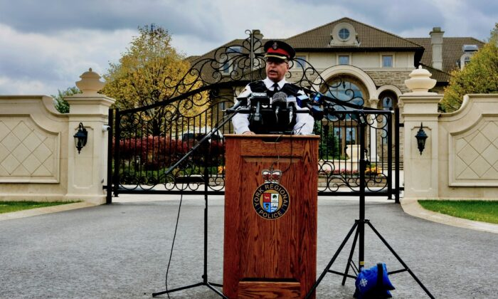 Superintendent Michael Slack with the York Regional Police holds a press conference in front of a mansion allegedly used to run an illegal gambling operation in Markham, Ont., on Sept. 30, 2020. (Becky Zhou/The Epoch Times)
