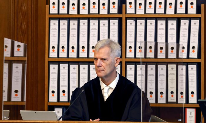Judge Olaf Arnoldi sits in the courtroom at the beginning of the trial of defendant Vadim K., in Berlin, Germany, on Oct. 7, 2020. (Odd Andersen/Pool via Reuters)